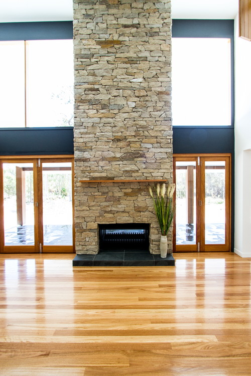 Blackbutt timber French Doors|Double Ceiling height stone fireplace